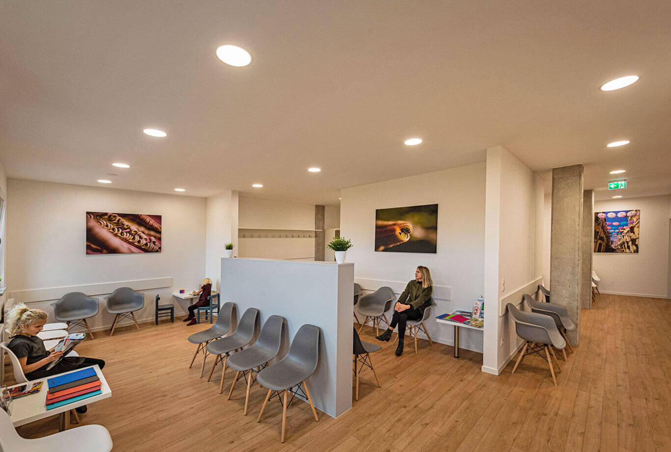 Three patients are waiting in the friendly, bright waiting area